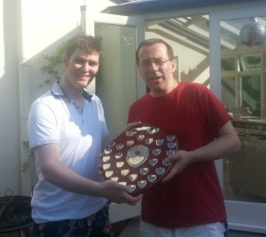 Last year's winner, Andrew Marley, presents the shield to this year's winner, Richard Webb